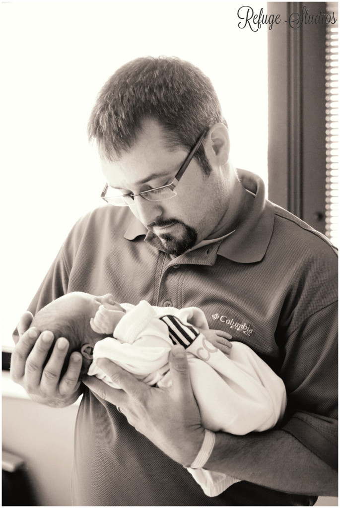 Father holding newborn son